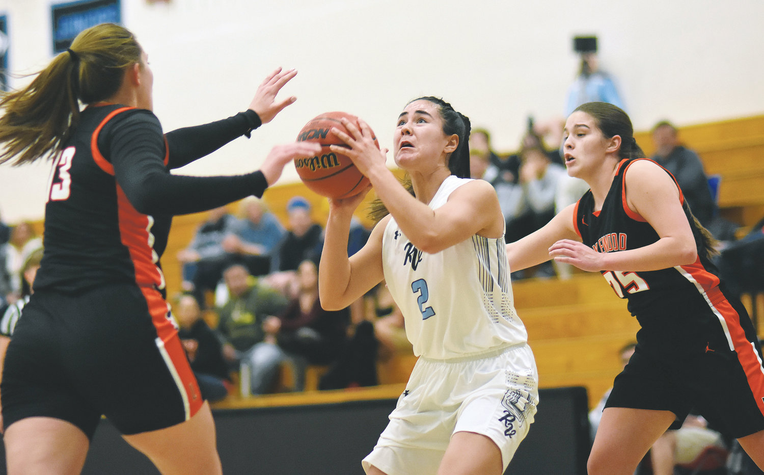Ralston Valley freshman Saya Sabus (2) attempts to get a shot off between Lakewood seniors Maddy Hubych (13) and Caira Salas (25) during a thrilling girls basketball game Jan. 15 at Ralston Valley High School. The Mustangs held on for a 67-65 meeting between the two teams who have won the last eight Class 5A Jeffco League titles.