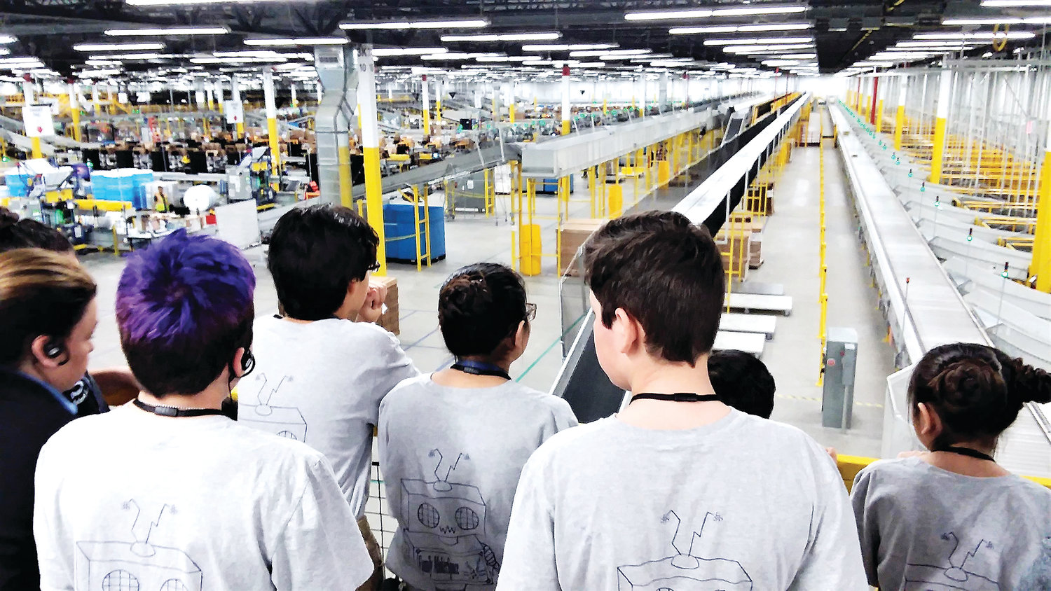 Students from Thornton's STEM Launch School look out over the Thornton Amazon warehouse April 10 from a fourth floor vantage.