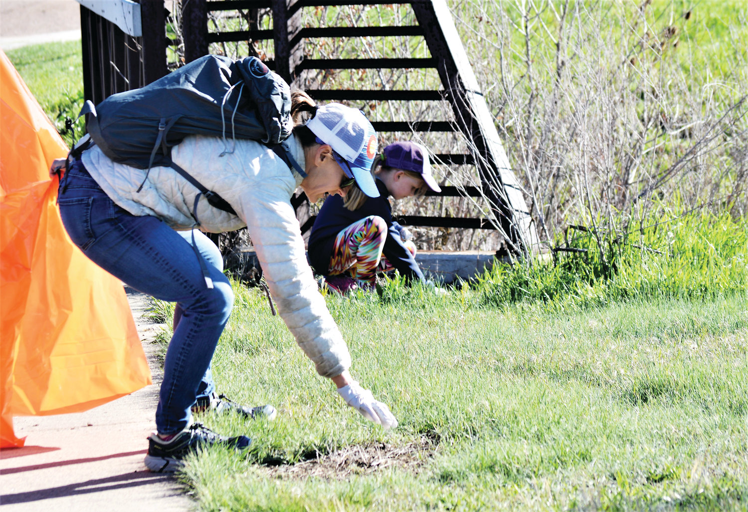 Aubrey Brenckle of Brighton, 7, and Marley Steele of Westminster both stoop to pick up trash along the Big Dry Creek Trail, part of the city of Westminster's Community Pride Day May 11.