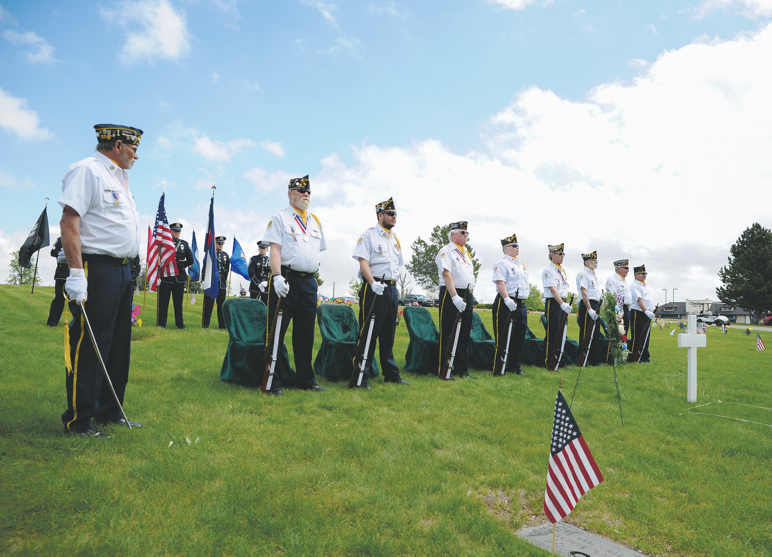 American Legion Post 22 Honor Guard stand at parade rest, during the outdoor portion of Memorial Day services  May 27 at Olinger Highland Cemetery in Thornton.