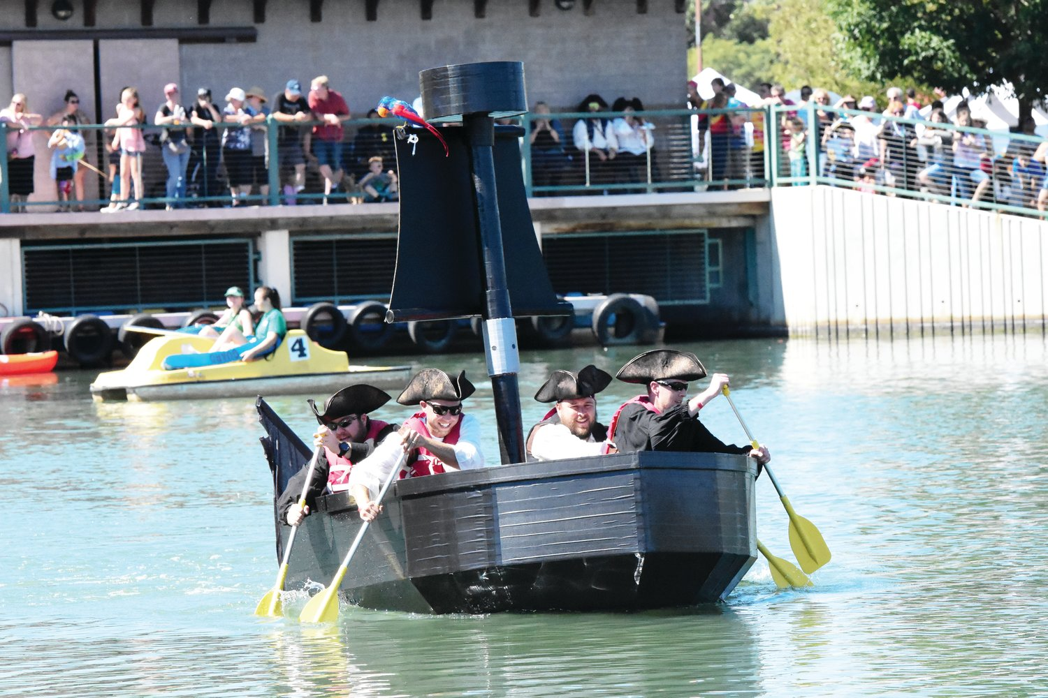 """The """"Sea Dog,"""" commanded by Captain Josh Otterstrom, front right, of Highlands Ranch, competes in this year's Cardboard Regatta at Northglenn's annual Pirate Fest Sept. 15 at E. B. Rains, Jr. Memorial Park. This vessel took 4 months to complete, according to Otterstrom."""