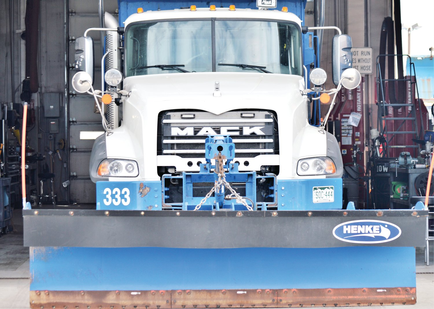 An Adams County loader, fitted with a snow plow, waits in the bay at the county's Commerce City maintenance facility Oct. 9 in preparation for the winter of 2019-20.