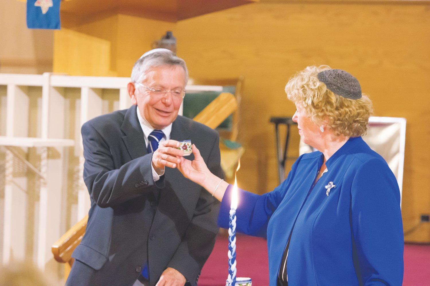 Rabbi Boaz Heilman, left, accepts a cup of wine from his wife, Rabbi Sally Finestone, during his formal installation as Rabbi of Westminster's Congregation B'nai Torah Nov. 9. Heilman succeeds Rabbi Anat Moskowitz, who moved to Florida for health reasons.