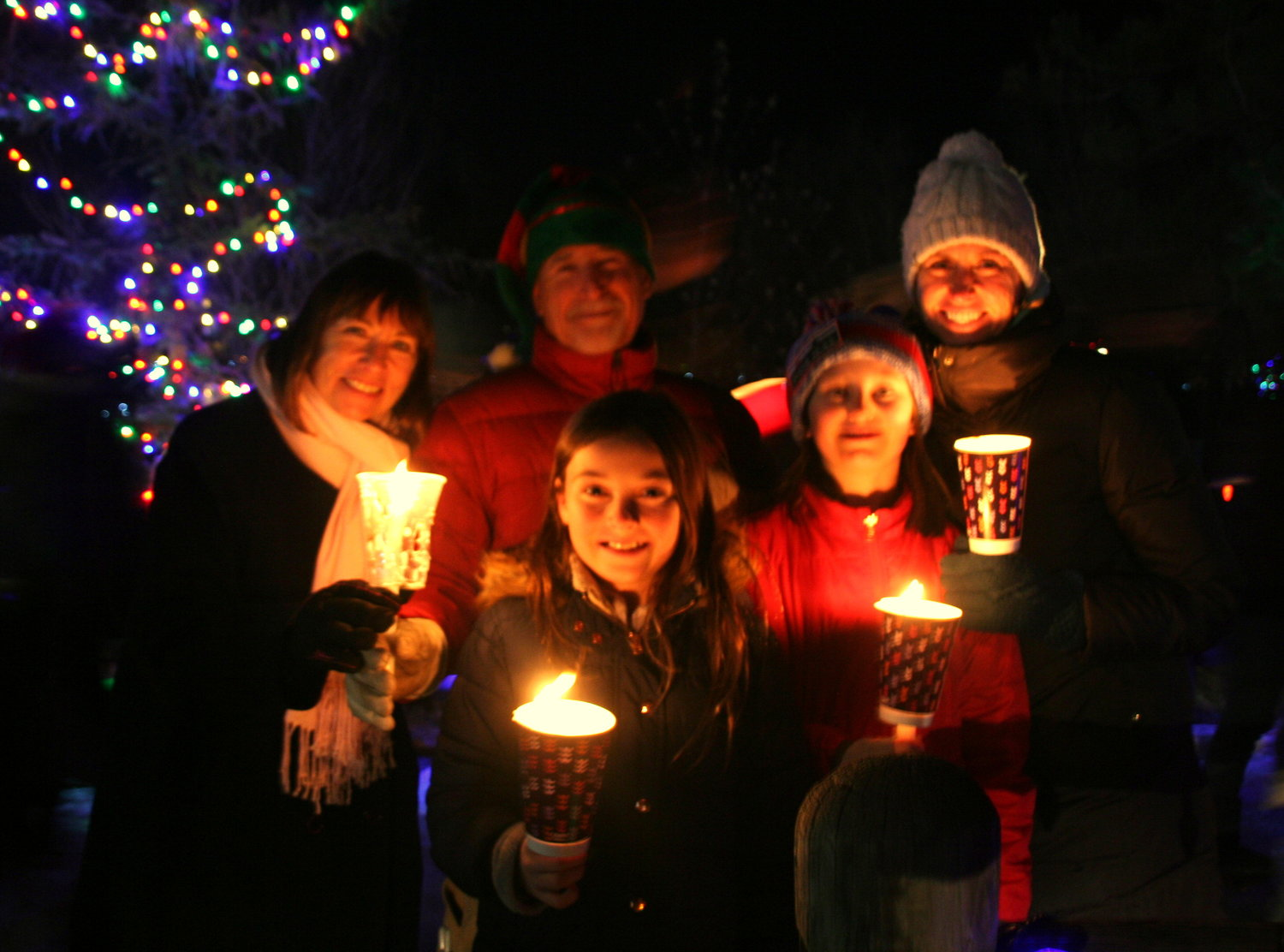The Karp, Roman and Vollmer families — a mix of Golden, Arvada and Denver residents — gather for a photo at the Candlelight Walk on Dec. 6.