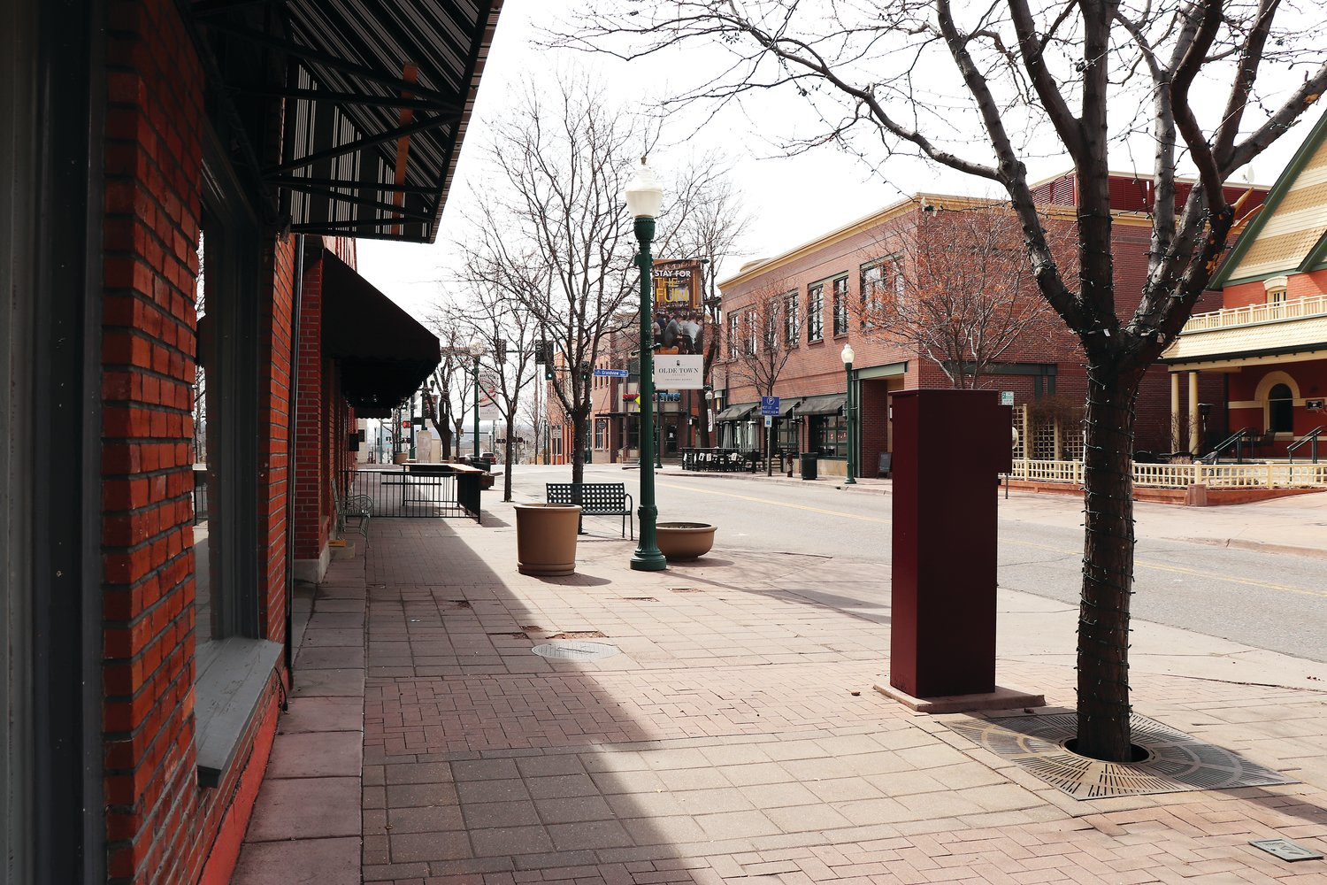 Olde Wadsworth Boulevard and the other streets of Olde Town were empty at lunchtime on St. Patrick's Day, after the state ordered restaurants and bars to suspend sit-down service. Outdoor seating, and loosening restrictions have since helped bring patrons back to the area.