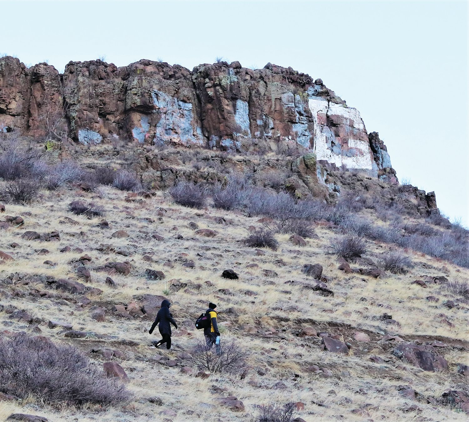 Hikers walk in front of the G on South Table Mountain on Jan. 15.