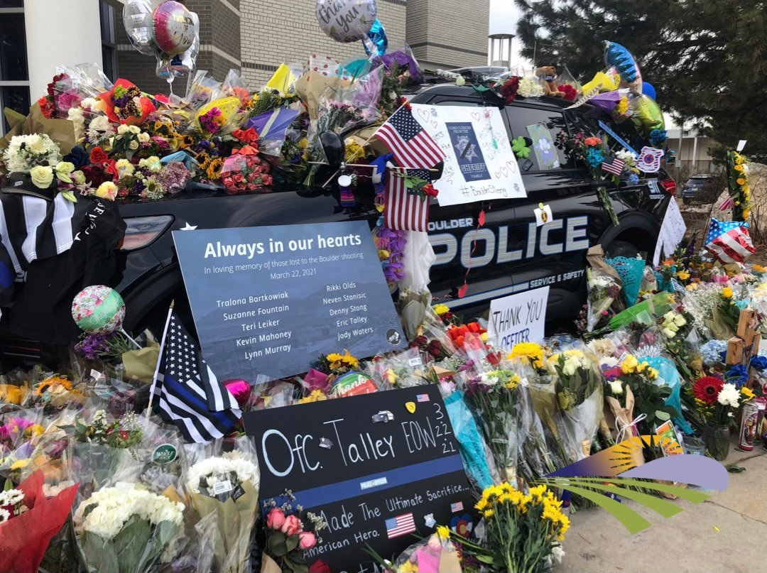 Courtesy Brighton police  Brighton police officers joined many others who have stopped by memorials in Boulder for the 10 people who died in a supermarket massacre March 22. Among the victims was Boulder Police Officer Eric Talley. Brighton officers paid respects to all 10 victims. A tweet from the Brighton department said a representative assisted the Colorado Fallen Hero Foundation Plan with Talley's services.