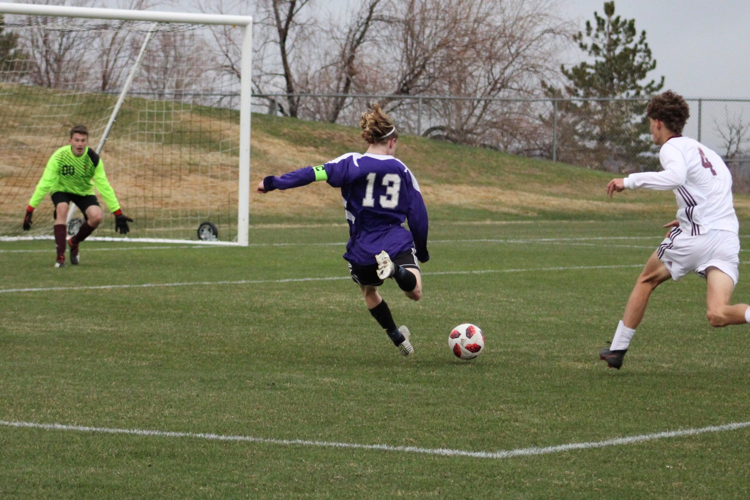 Arvada West's Noah Kanagy breaks behind the Golden defense and tries a shot on net in the Wildcat's 3-0 win over the Demons.