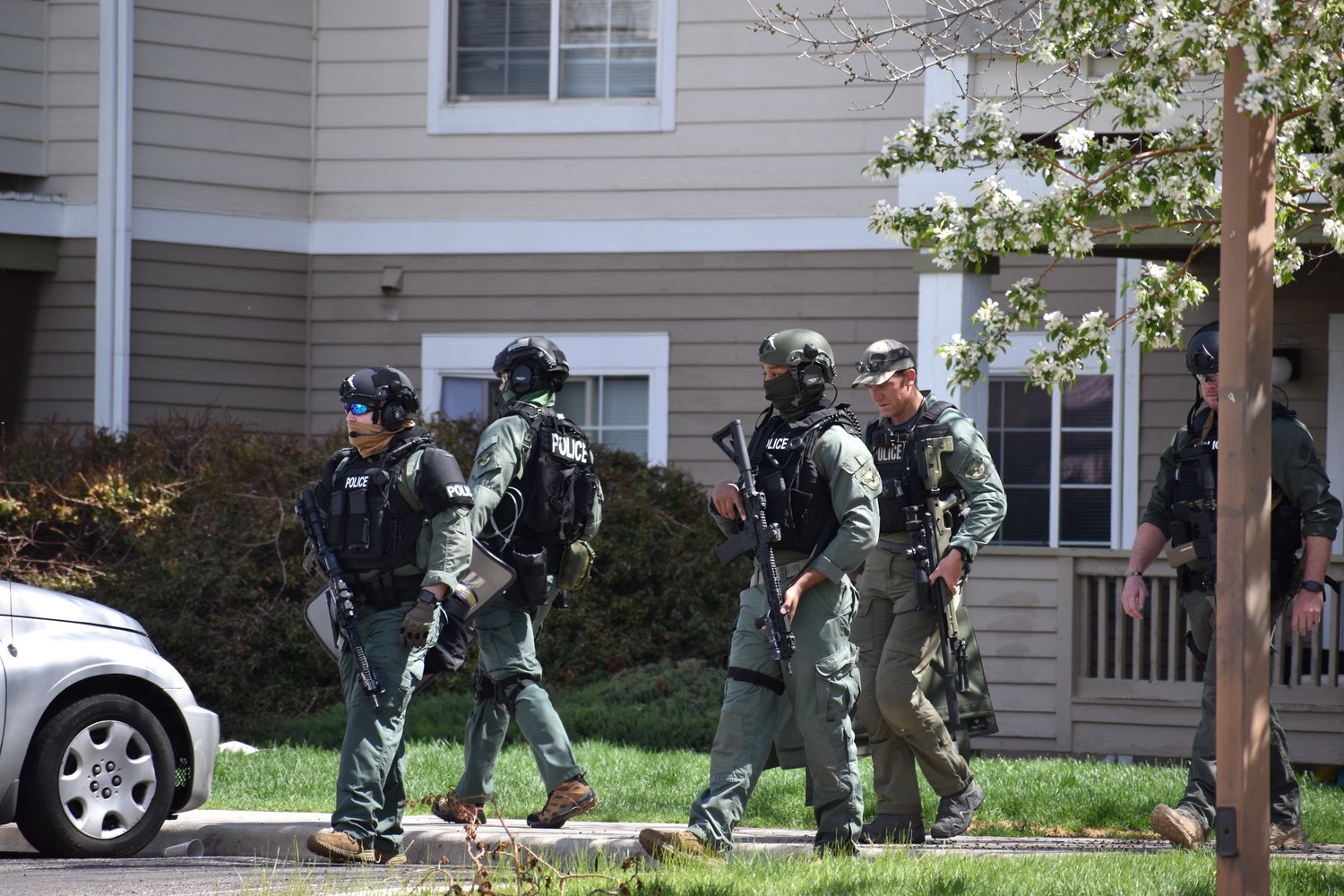 Swat teams leaving the Riverwalk Apartments in   Brighton. Police later said there was no potential threat to the community.