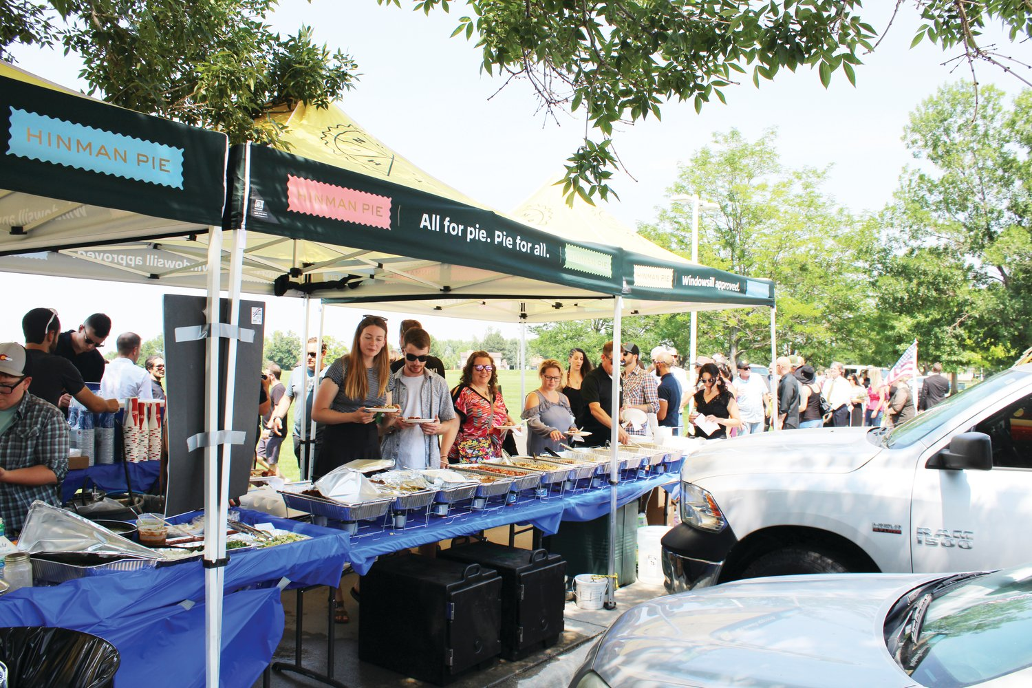 People line up for food and refreshments at the Johnny Hurley celebration of life event at Robby Ferrufino Park.