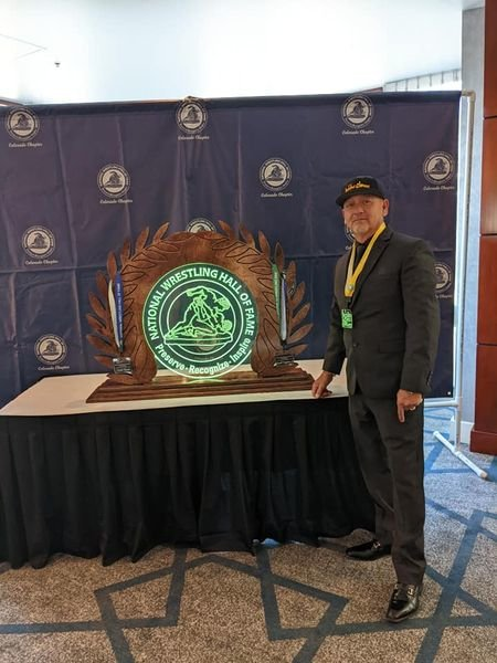 During the Colorado chapter of the National Wrestling Hall of Fame awards dinner Sept. 11, Fort Lupton alum Dean Abeyta received a special merit award for his contributions to the wrestling community.