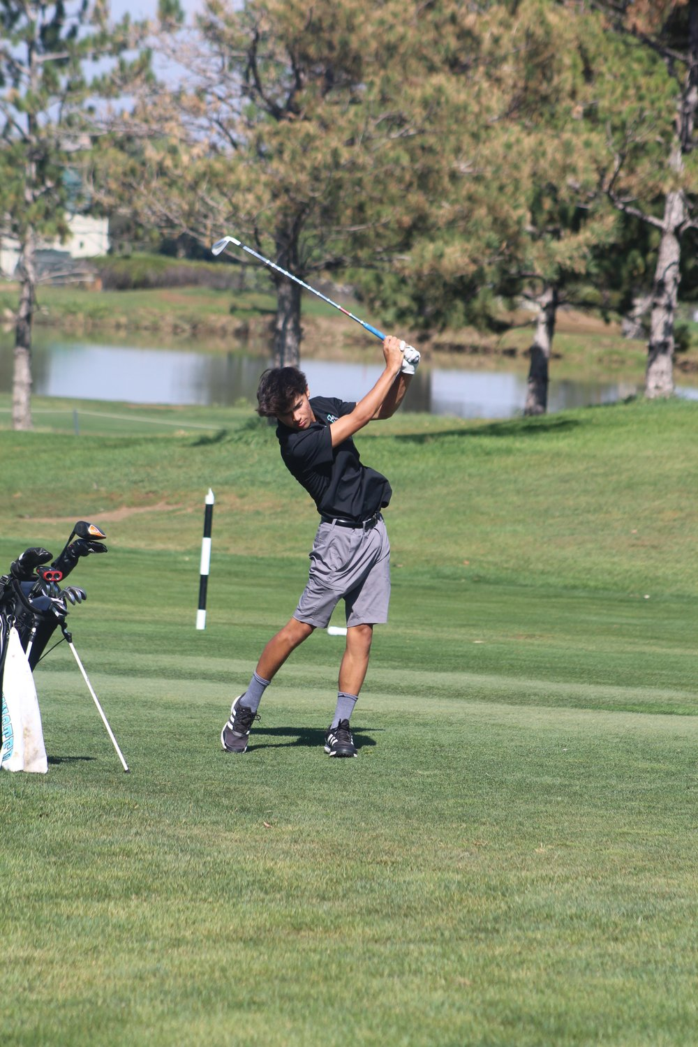 Westminster's Bielly Phasay sends this approach shot toward the first hole during the Eastern Metro Athletic Conference major )all-school) tournament in Westminster Sept. 14. Phasay finished in a tie for ninth place with a score of 90. Jerry Logan took 13th with his 92, and Trystian Martin finished his round with a 146.The Wolves finished fourth in the season standings, based on results from this tournament and a similar tournament in August.