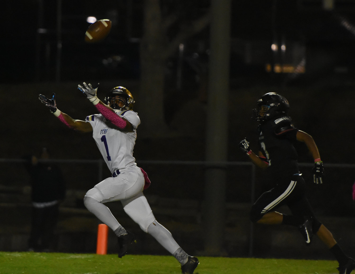 Fort Collins' Dorion McGarity, left, gets behind Westminster's Quentin Watson to catch a first-quarter touchdown pass Oct. 1 at Memorial Stadium. The Wolves rallied from a 28-12 halftime deficit to get within three points (35-32) early in the third quarter but scored no more, losing 56-32.