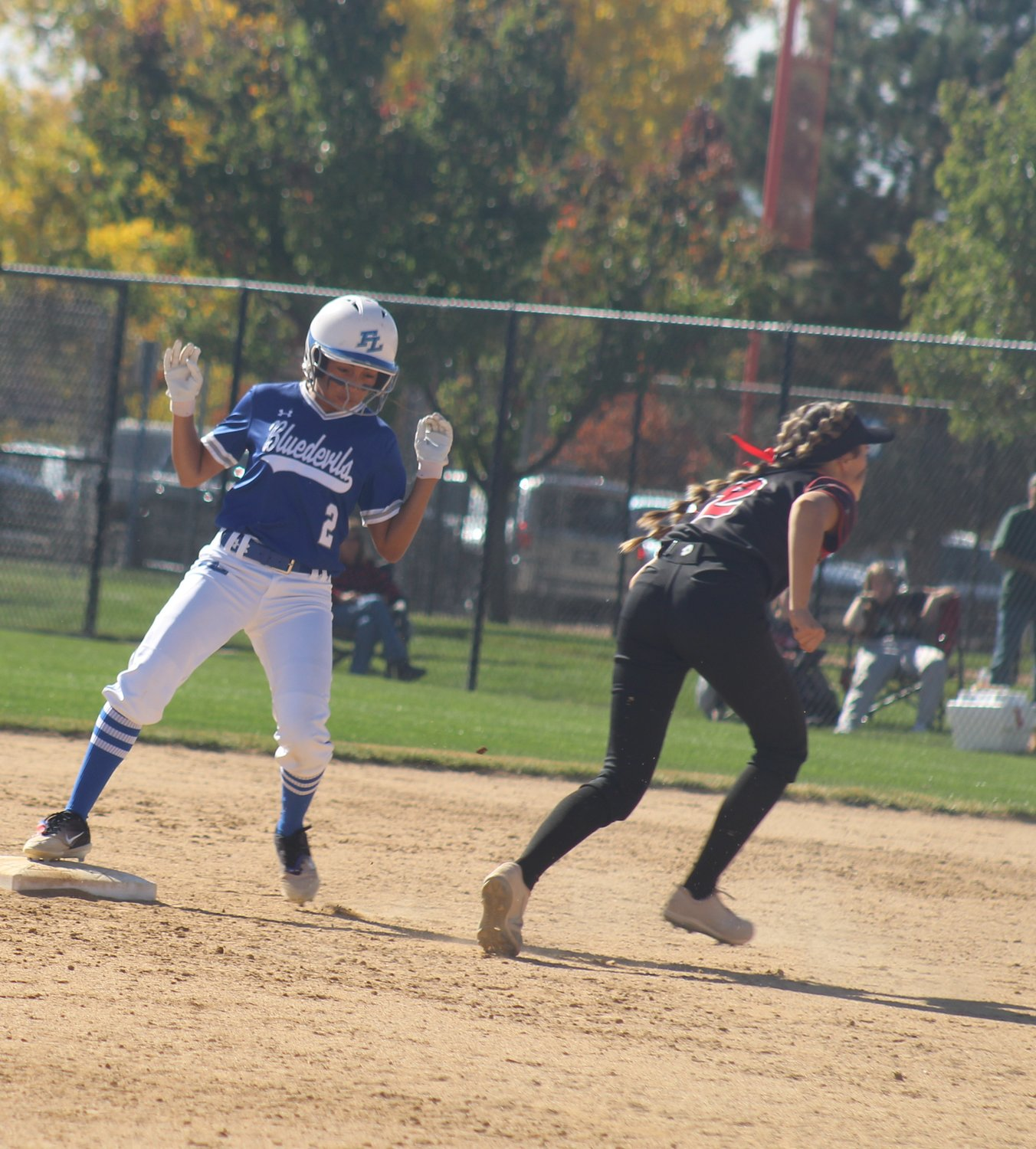 Fort Lupton's Rylee Balcazar gets into second base as avoids Strasburg shortstop Graecyn Graf in the process during the first round of the state 3A softball tournament Oct. 22 at Aurora Sports Park.