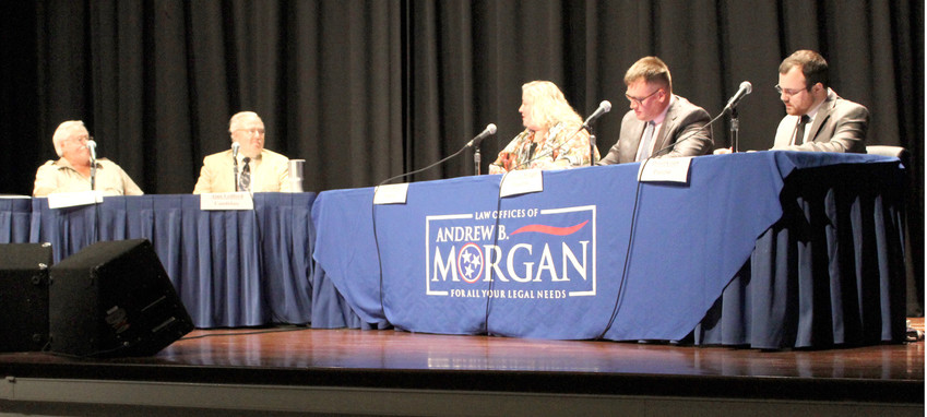 HOUSE DISTRICT 24 candidates Garry Moore and Alan Ledford answer questions during a debate Tuesday night at Cleveland State Community College. The moderators were Emily Beaty, Andrew B. Morgan and David Coats. During the debate, both candidates were supportive of gun carry laws, but differed on whether those who carry guns should undergo training. From left are Garry Moore, Alan Ledford, Emily Beaty, Andrew Morgan and David Coats.