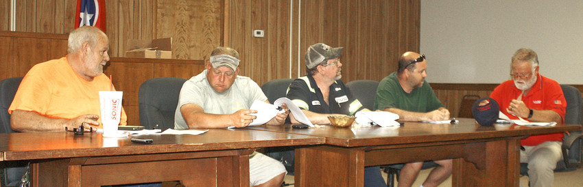 """POLK COUNTY COMMISSION members were focused on the proposed budget for the 2018-19 fiscal year at a called meeting Tuesday at the courthouse in Benton. Commission members include, from left, """"Buster"""" Lewis, Greg Brooks, Mike Curbow, John Pippenger and Mark Bishop."""