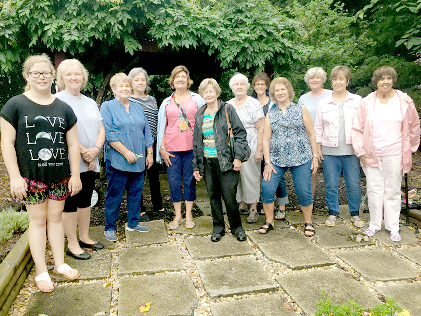 THE MAGNOLIA GARDEN CLUB recently met at the home of Charles and Sharon Guy, for its June meeting. The Guys showed the club its garden, and discussed various methods for landscaping. From left are Nichole Pulliam, Ginger Cloud, Sharon Guy, Fredricka Lawson, Carolyn DeVaney, Elsie Yates, Patsy Bettis, Brenda Nakdimen, Beth Cunningham, Linda Cross, Sue Taylor and Patsy Owenby.