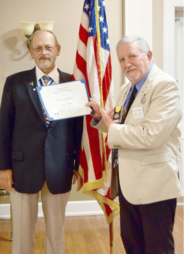 John A. Campbell III, right, was presented the SAR Liberty Medal by Chapter President James McKinney Sr.