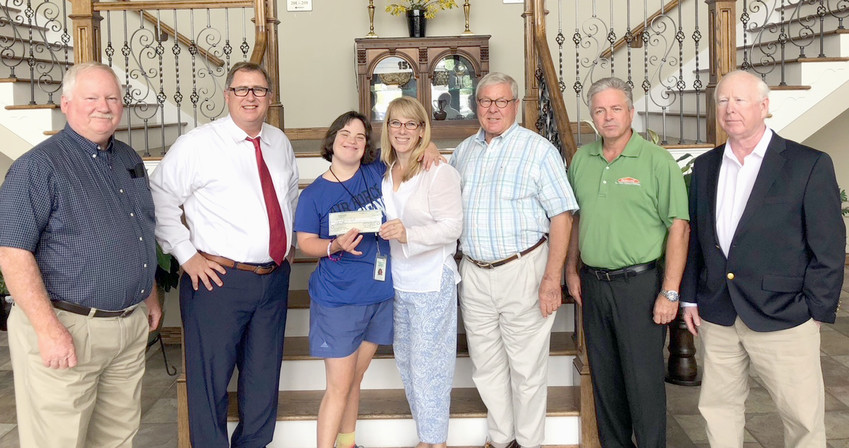 THE ORANGE GROVE CENTER received a check for $15,000 from the Bachman Foundation. From left are Bachman Foundation chairman Ken Weller, foundation director Mark Frizzell, Rachel Andry and her mother Heidi Hoffecker, GG Camp director Hal Baker, foundation vice chairman Jeff Gregory and foundation trustee Mike Sikes.