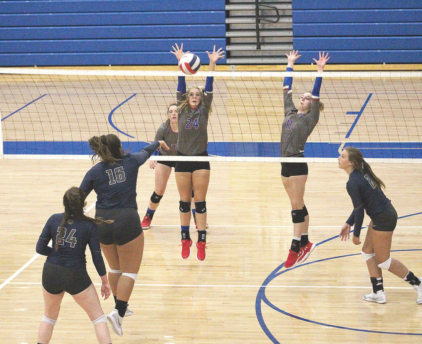 CLEVELAND LADY RAIDERS Madeline Dasher (24) and Nicole Glaser (11) go for the block on a shot by Walker Valley's Macy Nipper during District 5-3A volleyball Tuesday, in Raider Arena.