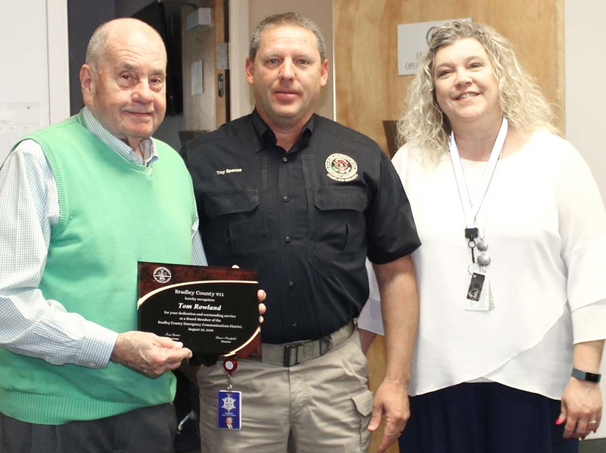CLEVELAND MAYOR Tom Rowland was recognized for his service to the Bradley County Emergency Communications District during Wednesday's board of directors meeting. From left are Rowland, Board Chairman Troy Spence and Bradley County 911 Emergency Communications Center Director Sherri Maxfield. Bradley County Sheriff Eric Watson was also recognized for his service on the board, but was not present at the meeting.