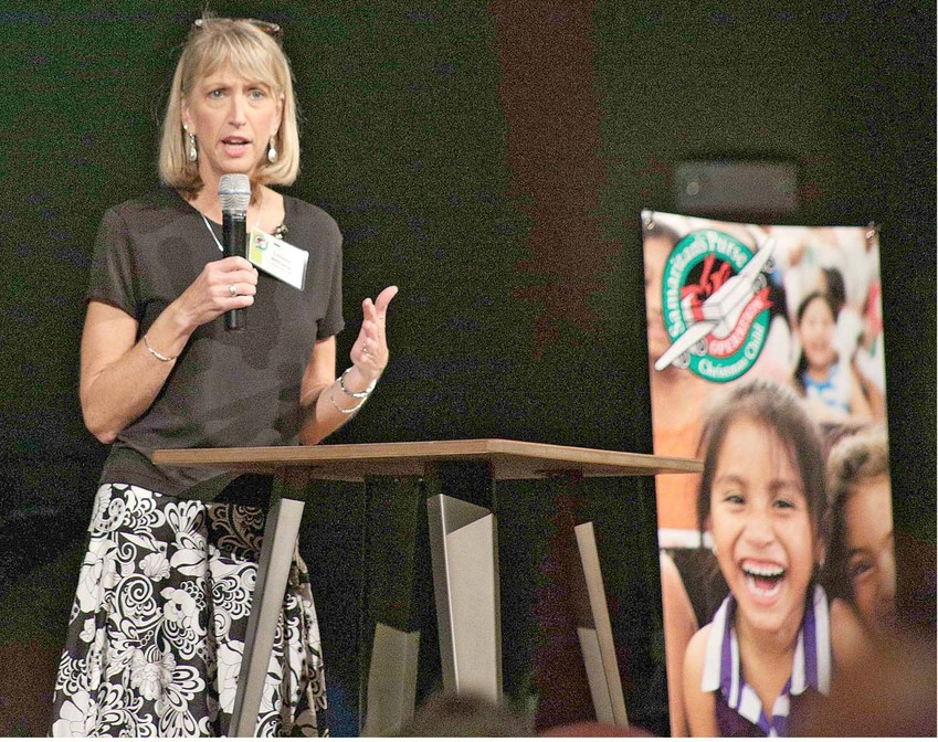 CHRISTY WILLIAMS, logistics coordinator for the Tennessee Valley Area Team for Operation Christmas Child, speaks to attendees at First Baptist Church during a kickoff campaign for Operation Christmas Child. Wilson introduced speaker Alex Nsengimana, who survived war and genocide in Rwanda