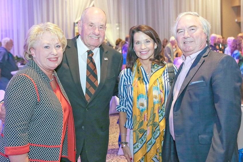 MAYOR TOM ROWLAND, and Cleveland's first lady Sandra, left, pose for a quick photo with Amy Banks and retiring City Councilman-At-Large Richard Banks at Thursday evening's reception. The two-hour event drew a huge crowd of friends and supporters who were offering their best wishes in the Cleveland mayor's retirement from public office.