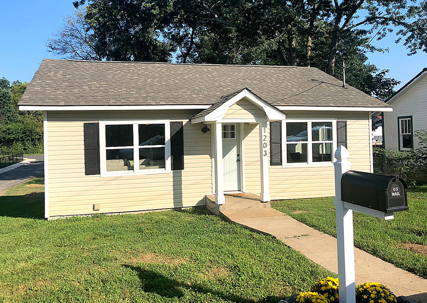AN OPEN HOUSE for a property renovated by nonprofit community development corporation City Fields was held Monday. The home was purchased by the organization with the help of the United Way of the Ocoee Region and renovated with a grant from Project Revitalization.