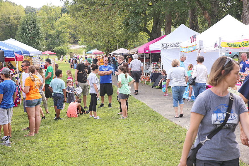 ATTENDEES OF THE 2018 International Cowpea Festival & Cook-off enjoy part of the vendor area at Saturday's festival.