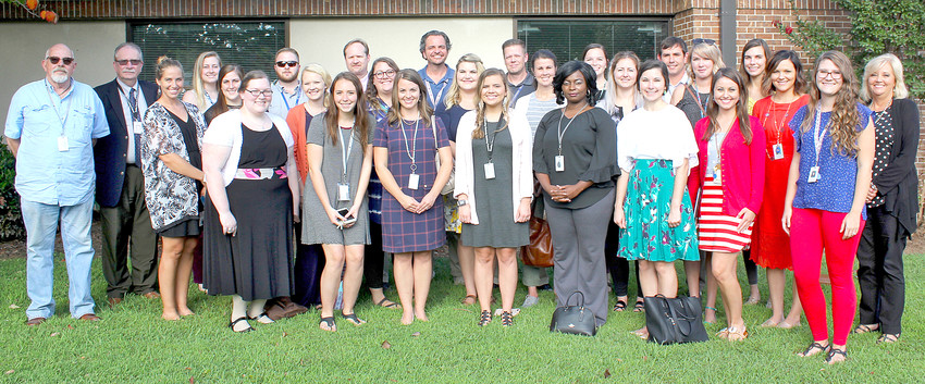 NEW TEACHERS for the 2018-19 school year were honored before a recent Bradley County Board of Education meeting. Joining the teachers are Supervisor of Secondary Education Danny Coggin, second from left, and Supervisor of Elementary Education Sheena Newman, far right.