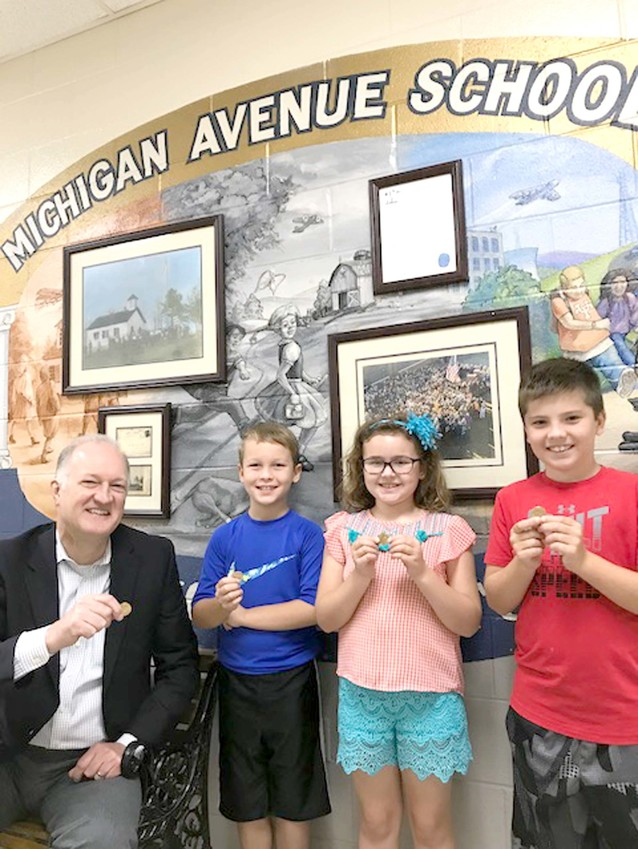 ATHENS FEDERAL Community Bank has been a longtime sponsor of the Michigan Avenue School Leader of the Month Program. When students are chosen as leaders, a part of their recognition includes a golden dollar coin. From left and displaying coins are Athens Federal Community Bank City President Jay Leggett, along with past Leader of the Month recipients Jace Lawson, Genevieve Owens and Andrew Carroll.