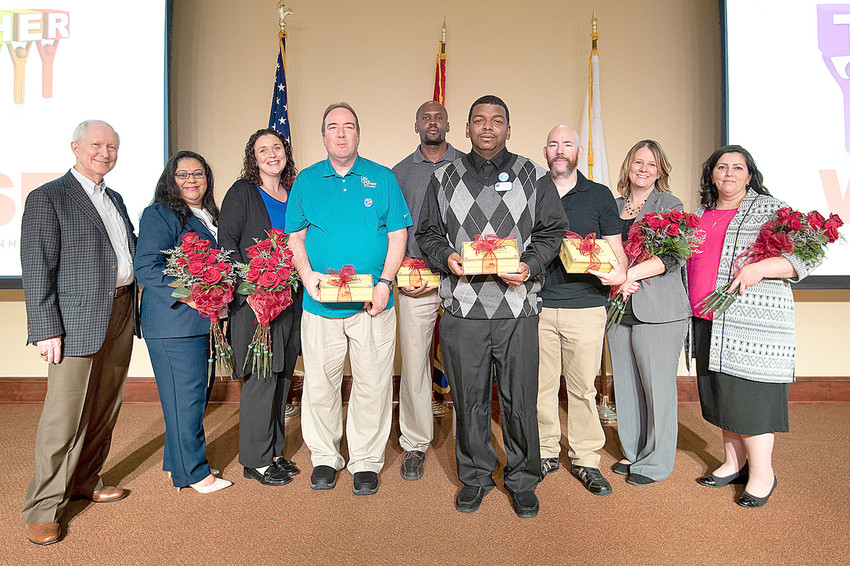 From left are Beecher Hunter, Life Care president; Herlinda Cartagena, certified nursing assistant at Life Care Center of Plano, Texas; Marie Brantley, CNA at Heritage Health Care Center in Globe, Ariz.; Allen Phillips, CNA at Life Care Center of Pueblo, Colo.; R.J. Jones, physical therapy assistant at Life Care Center of Jacksonville, Fla.; Tyrone Bryant, maintenance director at Life Care Center of Hilton Head, S.C.; Joe Leal, nurse at Life Care Center of Treasure Valley in Boise, Idaho; Tammi Conner, marketing director at Life Care Center of Osawatomie, Kan.; and Connie Costa, activities assistant at Life Care Center of Raynham, Mass.