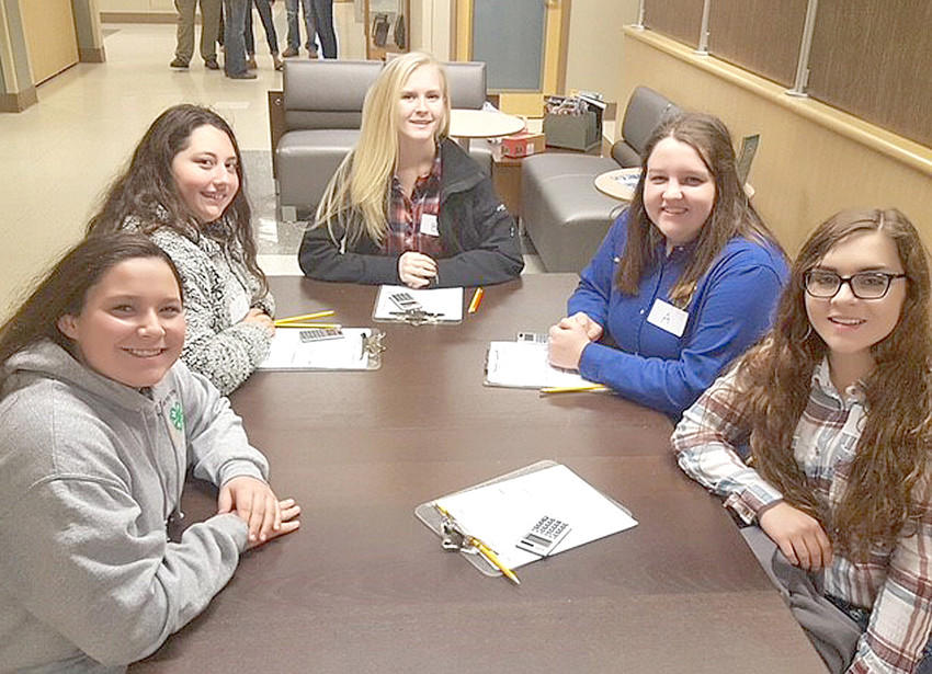 Jolee Neely, Stephanie Bates, HaLee Kazy, Keri Beth Cox and Bryleigh Campbell prepare for the Meats Judging Contest.  They were first in Team, along with Cox placing second overall, Kazy placing fifth, and Bates placing sixth.