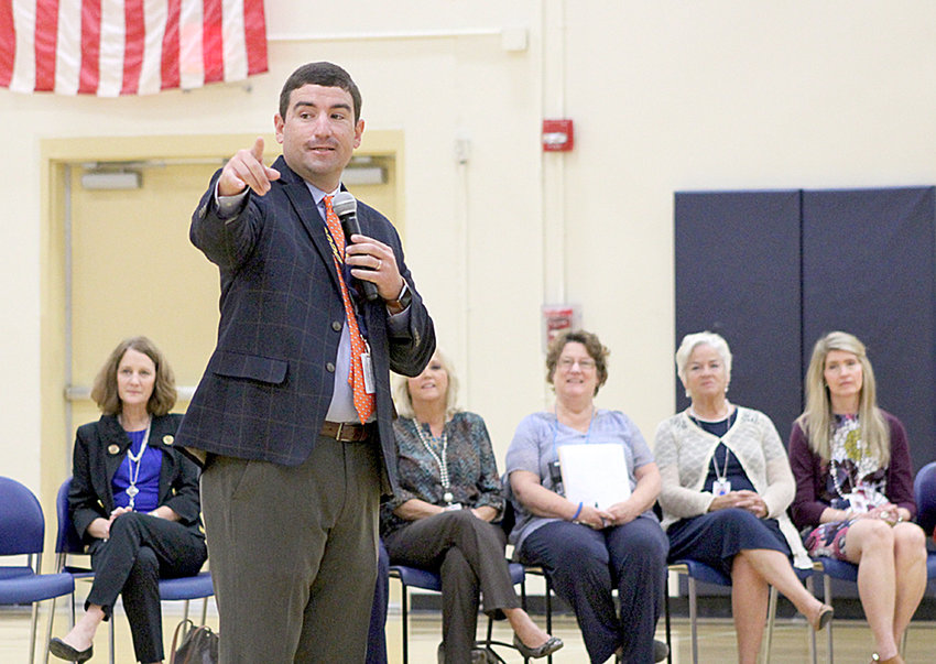 """COREY LIMBURG, principal of Ocoee Middle School, welcomes students and guests to a """"Colts Care Rally"""" at the school. Three assemblies — one for each grade —were held Friday to emphasize the need to be kind."""