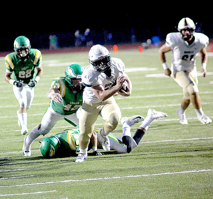 BRADLEY BEARS running back Parker Johnson eludes the tackle attempt of a Rhea County Eagle as he heads for the endzone Friday, in Evensville.