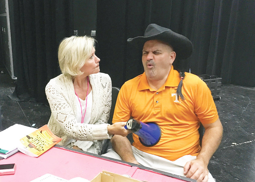 """CINDY BARNES (Tricia Pennington), a public relations expert, gives Mike Ferris (Chuck Martin), sales manager, a wakeup call to get this car contest moving in Ocoee Theatre's  musical """"Hands on a Hardbody."""" The Ocoee Theatre production will be presented at the Museum Center at Five Point on Saturday and Oct. 5 and 6 at 7:30 p.m.; and matinees on Sunday and Oct. 7 at 2:30 p.m. Tickets can be purchased online or before performances at the Museum Center at 5 Points on Inman Street in Cleveland. If you need more ticket information, call 423-284-8209."""