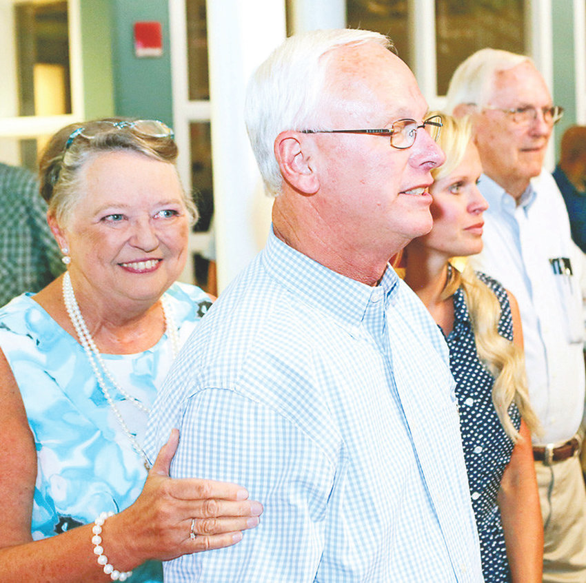 KEN WEBB, foreground, watches election returns with his wife, Dianne, left, daughter, Rebecca, right, and Gerald Kersey as Webb is elected as councilman-at-large for the city of Cleveland on Aug. 2.