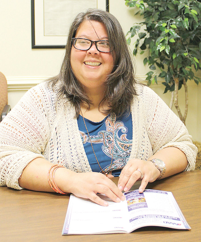 AMY WILSON LOVES her new job. The Bradley County native has been with the Southeast Tennessee Area Agency on Aging and Disability for about six months, assisting local seniors and the handicapped in qualifying for the Supplemental Nutrition Assistance Program, or SNAP, also known as food stamps.