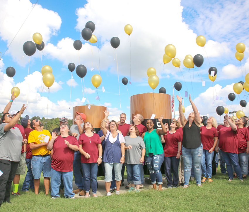 BALLOONS AND MESSAGES drift away from the Duracell Packing Center on Monday, at a balloon release celebration.