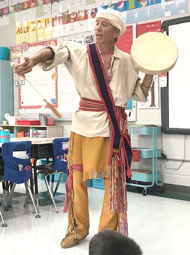 "Oak Grove Elementary School second-graders recently read a story called ""Cherokee Stickball Game"" and learned about some of the Cherokee culture. They enjoyed a visit from Jamie Russell to end the weeklong study. Mr. Russell shared music, traditions, and amazing stories of the Cherokee people.  Students in Mrs. Duncan, Mrs. Hall, and Ms. Mason's classes were able to handle and learn all about the many artifacts Russell brought in, and hear the Cherokee language spoken and sung with some of the handmade instruments. (Contributed photos)"