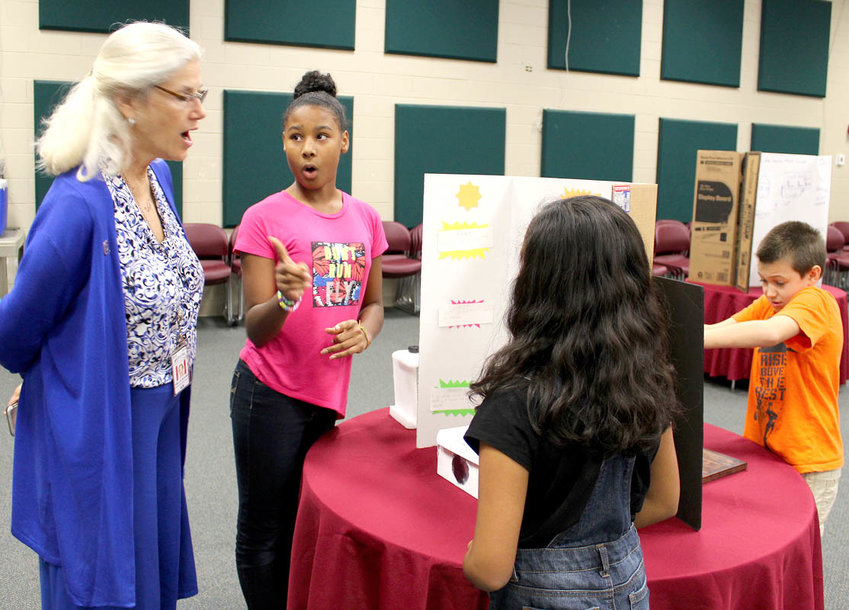 STUDENTS wow judge Kellye Bender with their projects during the first Engineering Day event held for fifth-graders at Blythe-Bower Elementary School.