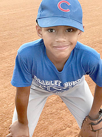 KADEN EDWARDS of the Bradley County Parks and Recreation 7/8 year-old Cubs pulled off an sparkling unassisted triple play in a recent 11-4 win over the Orioles. The Cubs are coached by Chad and Angela Chism and Tim Franks.