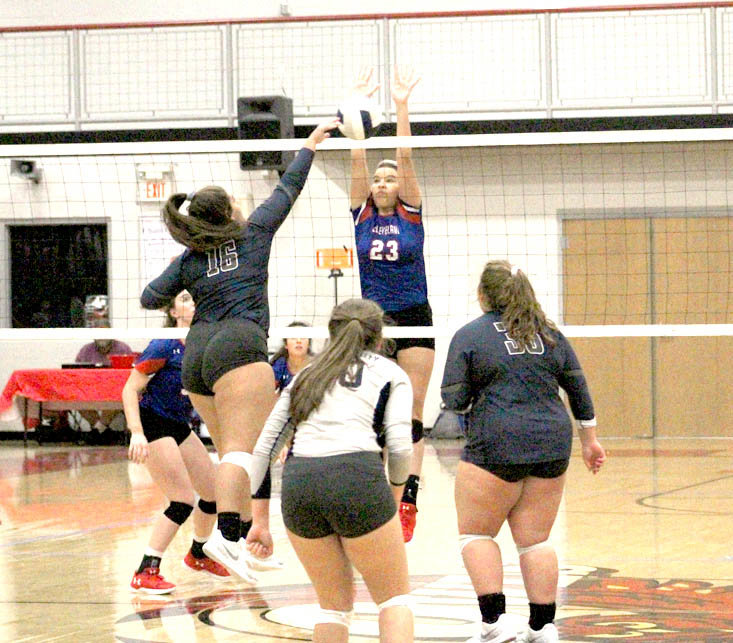 CLEVELAND MIDDLE BLOCKER Cydney Brock goes up to stop a shot by Walker Valley outside hitter Macy Nipper during the District 5-3A tournament. The Lady Mustagns and Lady Radiers will be looking for a region title beginning Monday, in Cookeville.