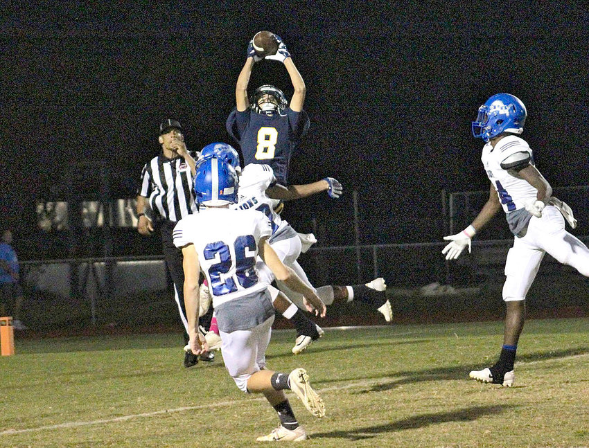 "WALKER VALLEY sophomore Kangel Sabany (8) leaps to make a touchdown grab in the final seconds of a non-region contest against Red Bank, Friday inside ""The Corral."" The Mustangs will face another tough challenge with a road trip to Knoxville Catholic Friday."