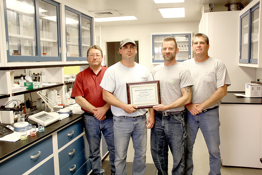 CLEVELAND UTILITIES employees pose with an award from the Kentucky/Tennessee Water Environment Association in recognition for their operational excellence at the utility's wastewater treatment plant last year. From left are plant supervisor Mike Ward, certified operators Nick Ownby, Jimmy (Pac) Lewis and chief operator Mark Lyles. Not shown are certified operators James Ledford, A.C. Cooper, Darrel Hubbard, Justin Shell and lab analysts Melanie Arnwine and Mark Wells. This award is shared with the CU Facilities Maintenance Department and the Environmental Regulatory Compliance Department.