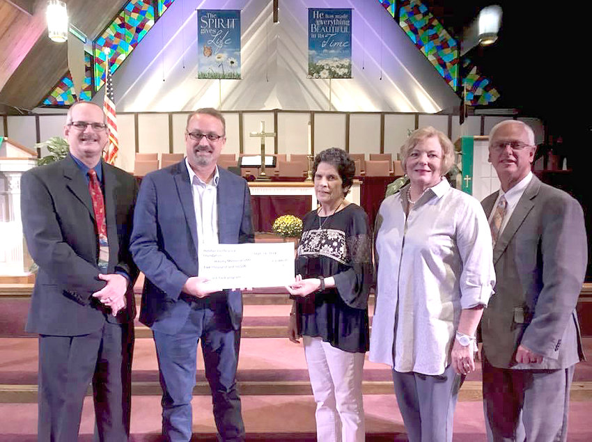 REPRESENTATIVES of Wesley Memorial United Methodist Church accept a check for $5,000 from the Holston Conference Foundation, for its Sack Pack ministry. From left are Wesley Memorial Senior Pastor Ramón Torres; Paul Bowman of the Holston Conference Foundation; Sack Pack program coordinator Diana Whittle; and Patti Hunt and Ken Webb, both of Wesley Memorial.