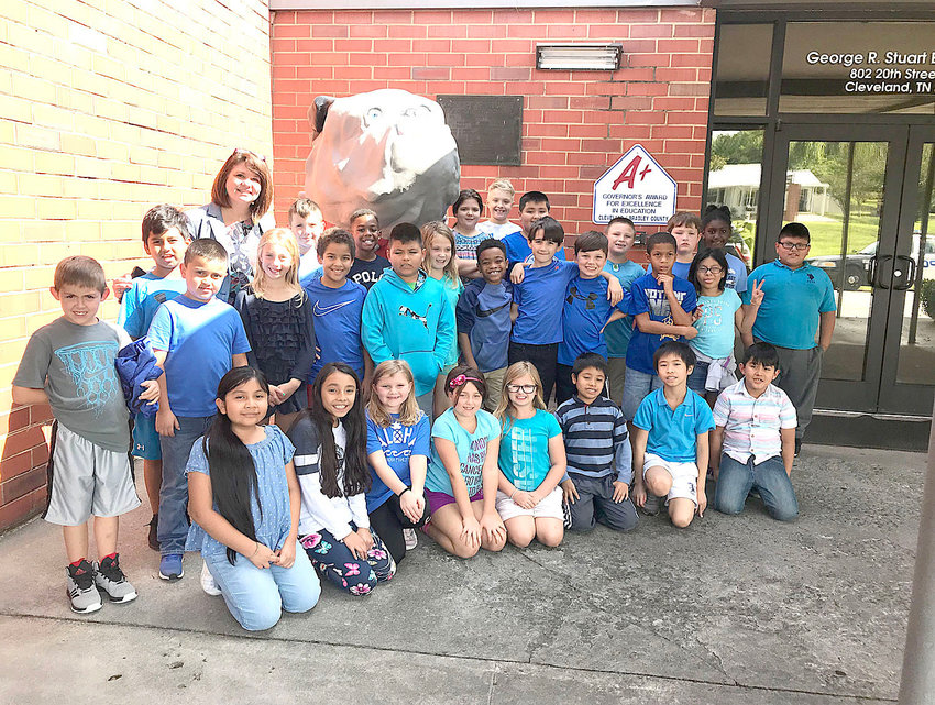 Students in Stuart Elementary's third-grade class were wearing blue in support of the movement to Stomp out Bullying Joining the students was Mrs. Richelle Shelton, school principal.  A Twitter handle – #Blueup Day – was also used in the anti-bullying effort.
