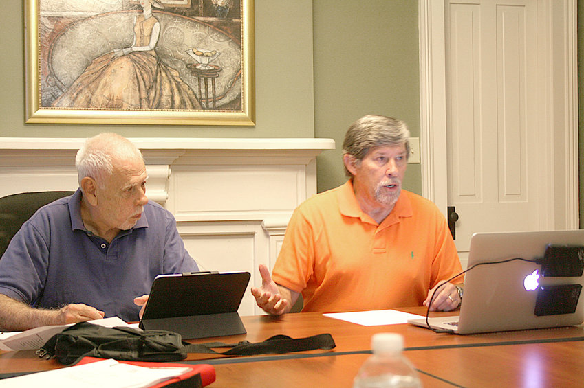 LARRY BINGHAM, left, sits alongside Ken Phillips, right, as the two explain how word count affects exactly what type of book you have, be it flash fiction, short story, novellete, novella or novel.