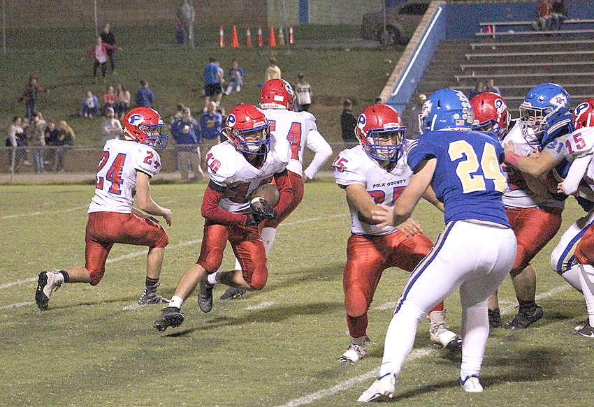 POLK COUNTY running back Levin Harz (10) looks for an opening in the first half against Bledsoe County Friday, in Pikeville. The host Warriors stunned the Wildcats  3-0 in overtime.