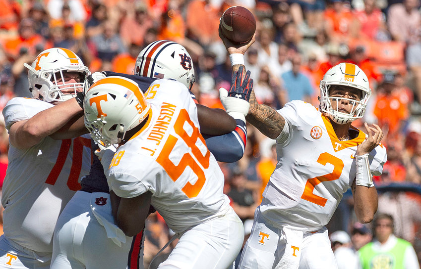 TENNESSEE QB Jarrett Guarantano (2) throws under pressure during the first half of Saturday's SEC game in Auburn, Ala. The Vols upset the No. 21st ranked War Eagles to snap an 11-game SEC losing streak.